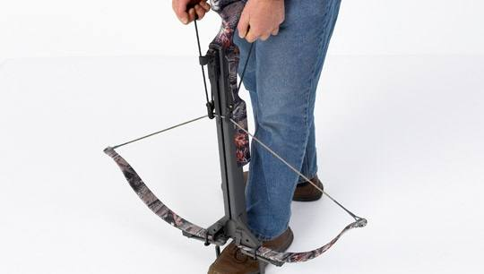 Man Cocking Crossbow