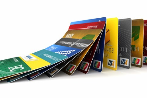 Credit cards in a row falling - credit card debt concept
