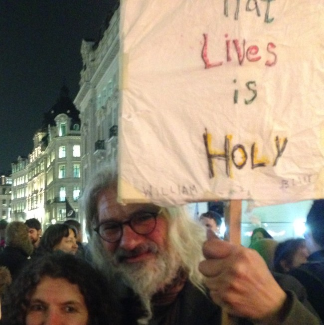 Stephen Micalef holding quotes in Oxford Circus