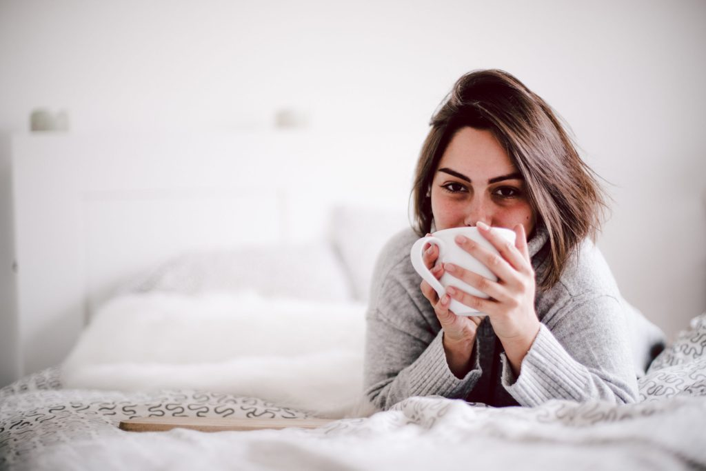 Woman woke up doing great and is now happily drinking coffee