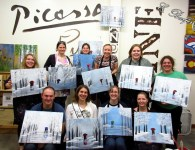 Our whole group and their completed paintings