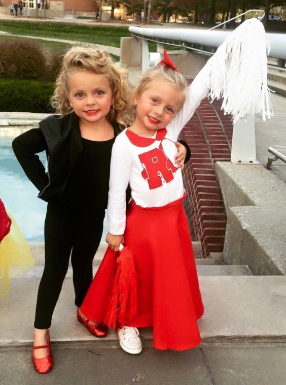 Good and bad Sandy from Grease Halloween costumes for sisters