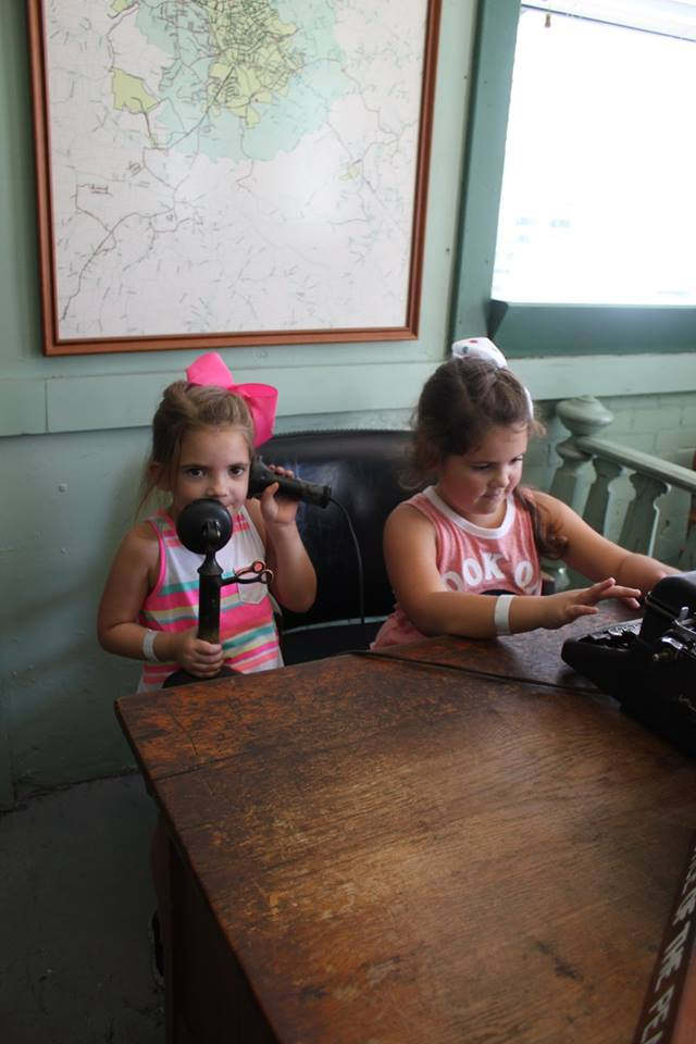 Kids playing at Sheriff Andy's desk