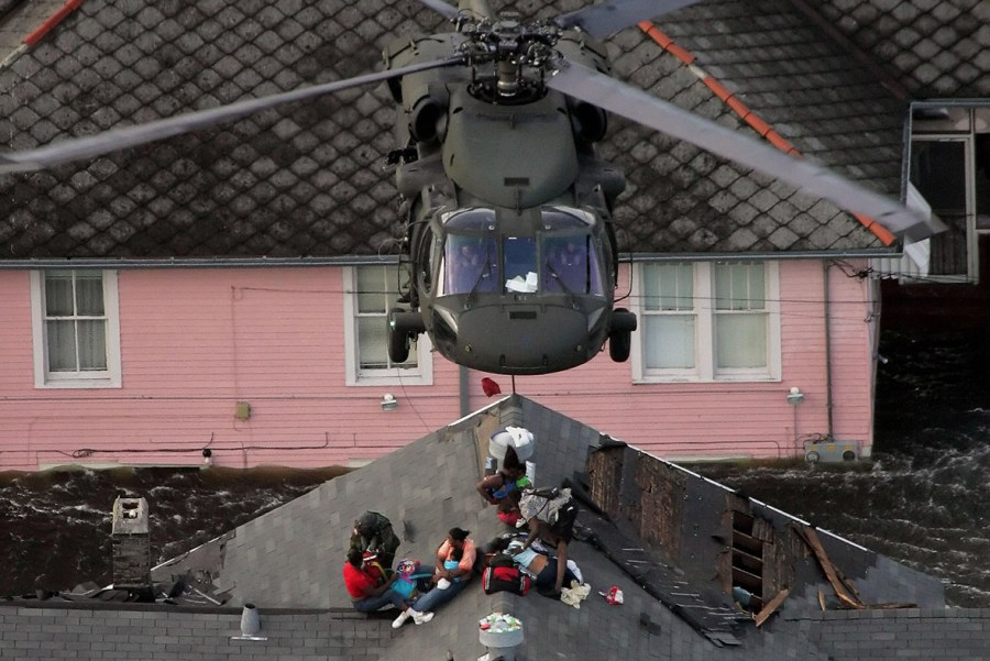 helicopter rescues flood victims on roof
