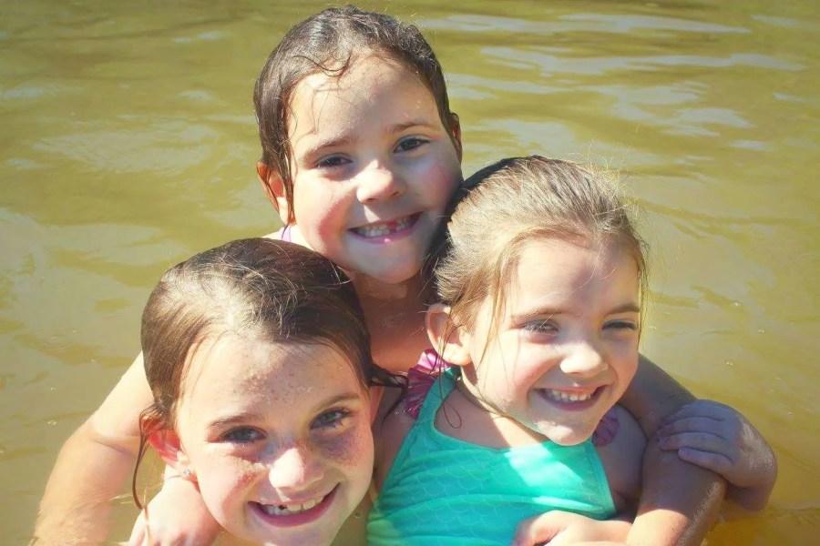 kids swimming at Falling Waters State Park lake