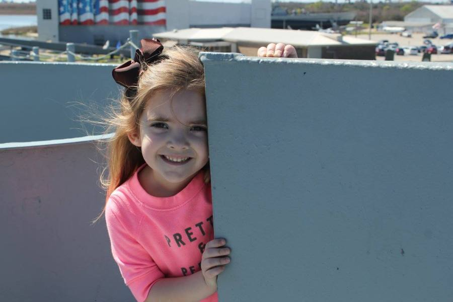 girl on deck of USS Alabama battleship