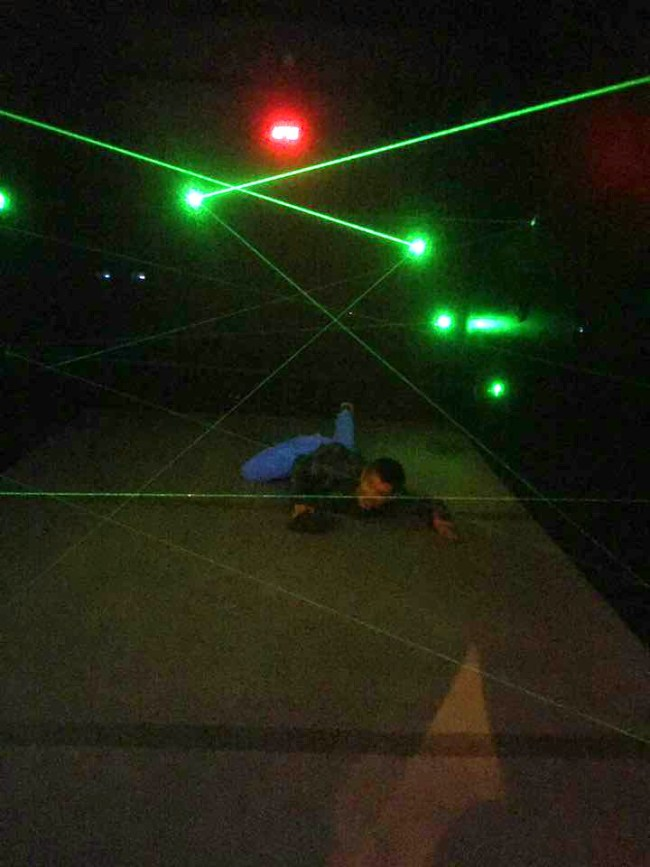 man completing the laser maze at the Island at Pigeon Forge, TN.