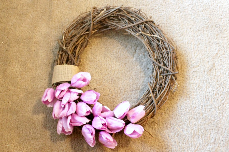 how to make a spring wreath - place tulips half way around the bottom of the grapevine wreath