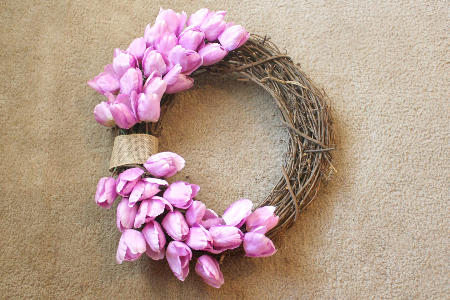 how to make a spring wreath - place tulip stems along the top half of the wreath