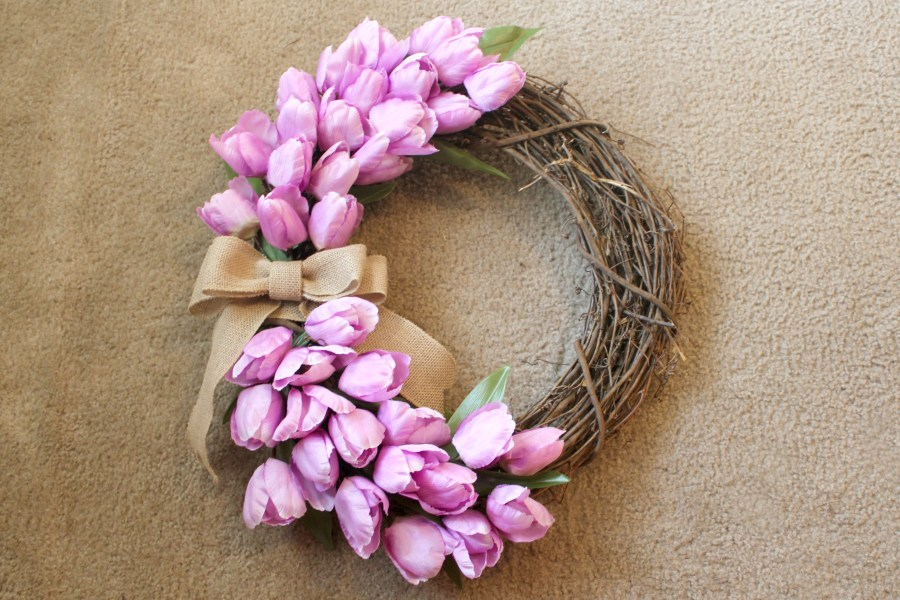 how to make a spring wreath - add burlap bow as the finishing touch to your wreath