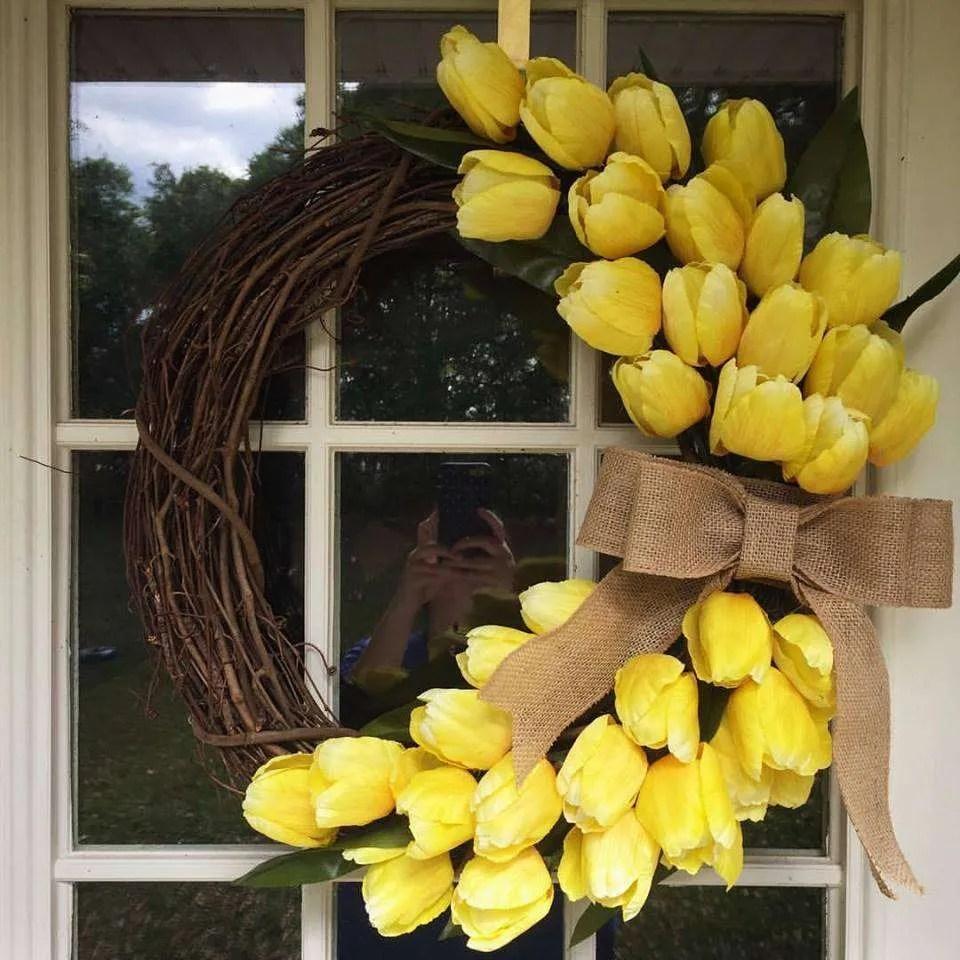 DIY tulip wreath using yellow tulips and burlap ribbon