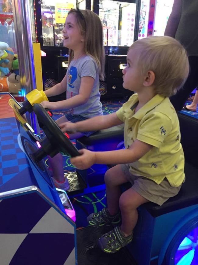 kids playing a racing game at Fun Stop arcade in Pigeon Forge