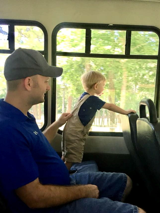 Father and son using free shuttle service at Stone Mountain.