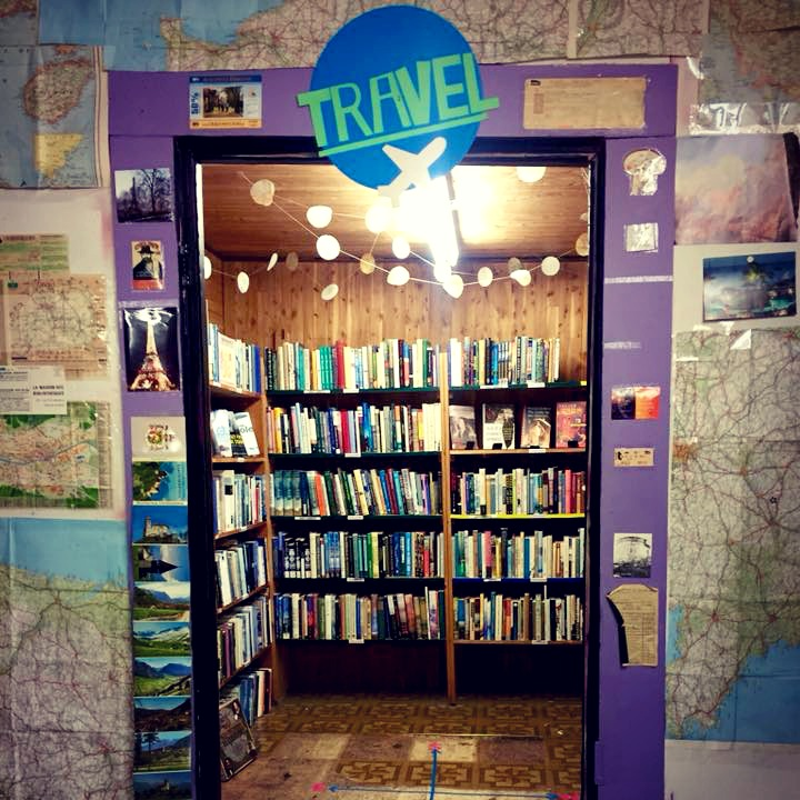 The travel section at Recycled Books in Denton, TX.