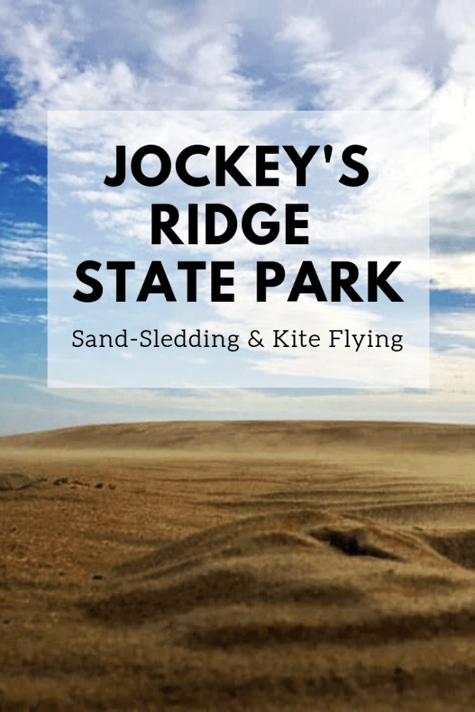 See our adventure sand sledding and kite flying at Jockey's Ridge State Park. | Finding Mandee