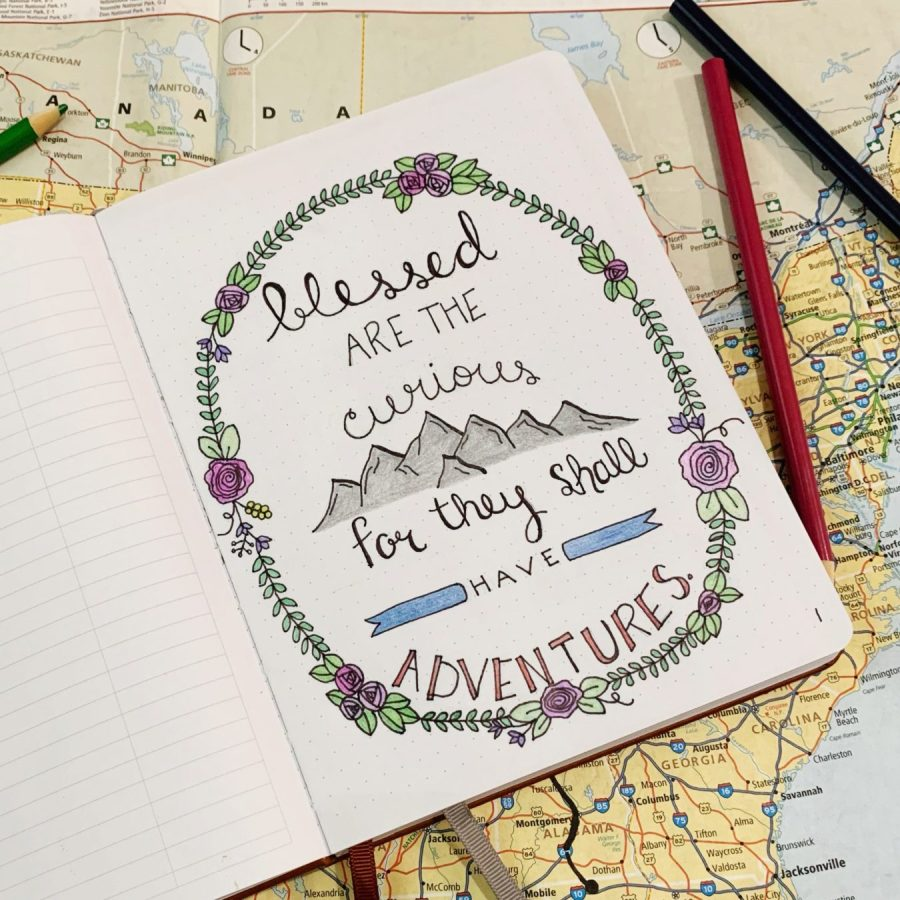 """The first page in my travel bullet journal is the quote """"Blessed are the curious, for they shall have adventures."""""""