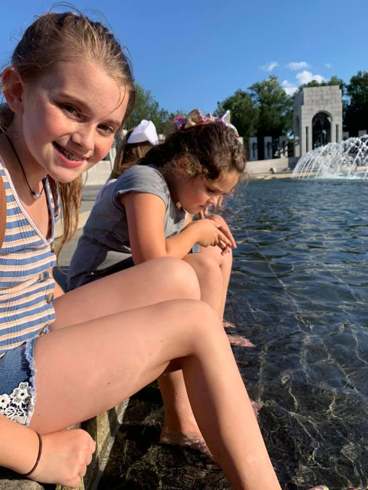 Resting our tired feet at the WWII Memorial in Washington D.C.