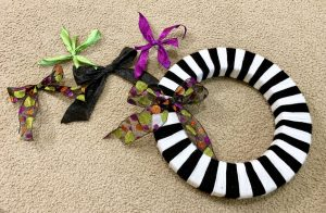 Making bows for a skull Halloween wreath.