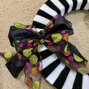 Bows placed on the DIY Halloween wreath.