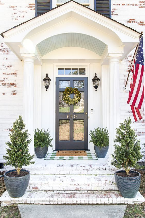 Decorate your front stoop with simple symmetry.