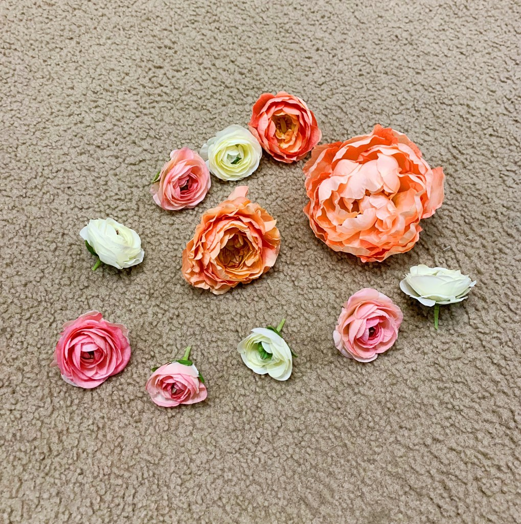 Step 2 to making a peony wreath is to cut the peonies from their stems.