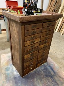 After staining the cabinet.