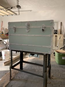 After painting the wooden portions of the steamer trunk.