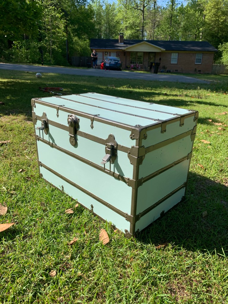 The vintage trunk after we painted the hardware.
