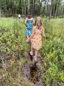 The girls taking the muddy path.