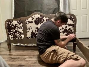 Putting together our refurbished antique bed.
