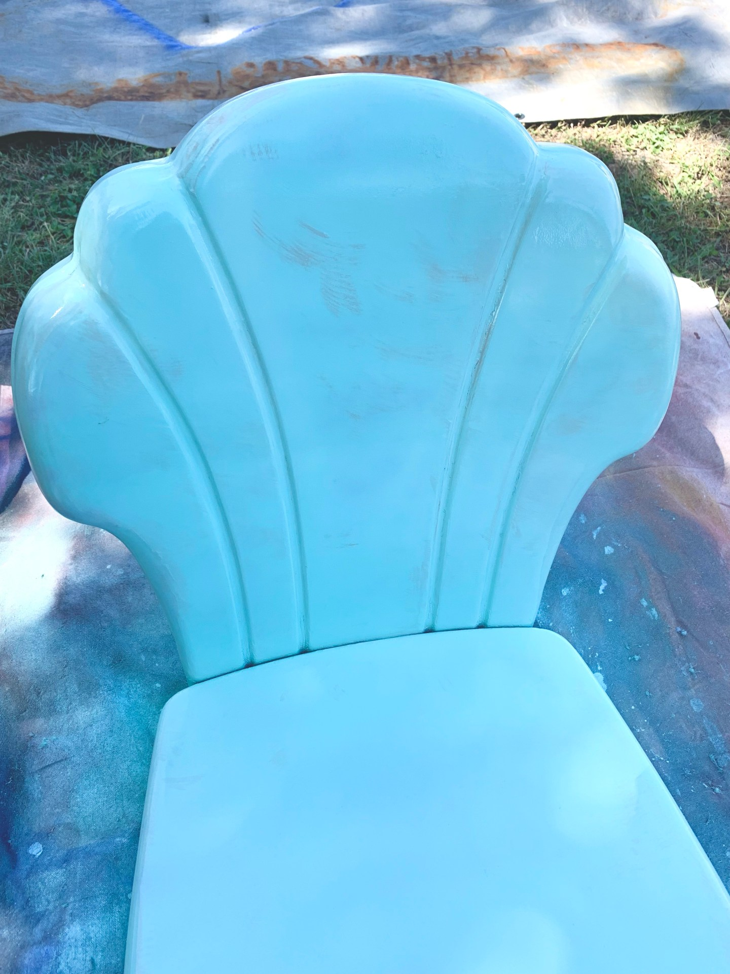 Use primer when painting vintage metal chairs to prevent bleed through.