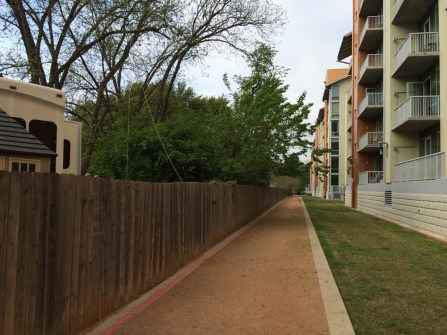 Trail to the lake - pricey condos one side, RV park on the other