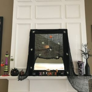 Fireplace mantle decorated for Halloween