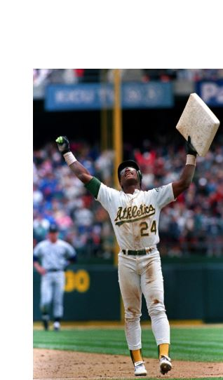 Rickey Henderson breaking Lou Brock's stolen base record. Holding up base.