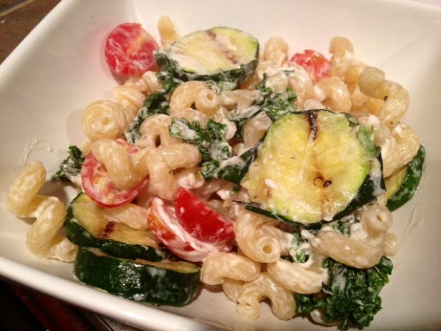 Kale & zucchini pasta with goat cheese & tomatoes