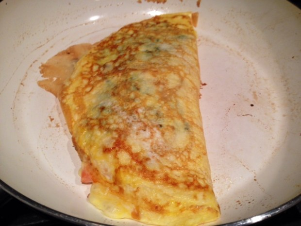 Omelette with Caramlelized Onions Kale & Goat Cheese finished