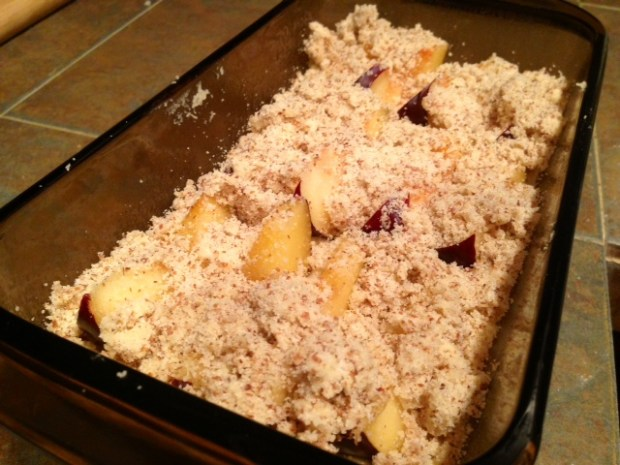 fluffy plum cake with almond crumble assembled