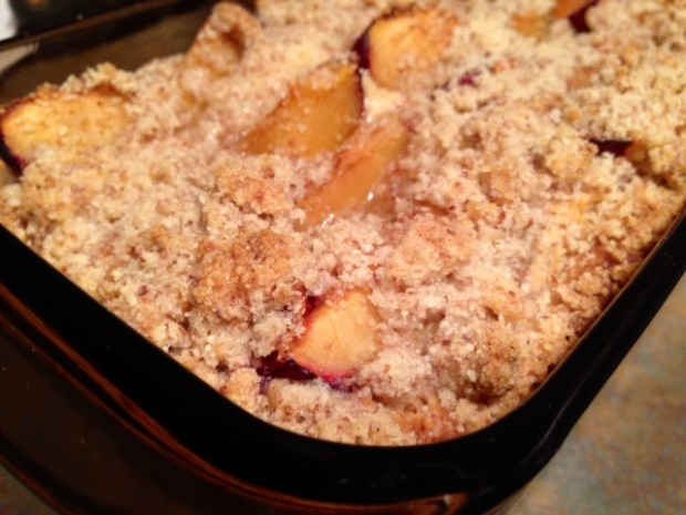 fluffy plum cake with almond crumble baked closeup
