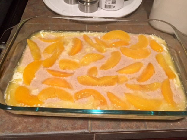 peach raspberry cobbler batter peaches