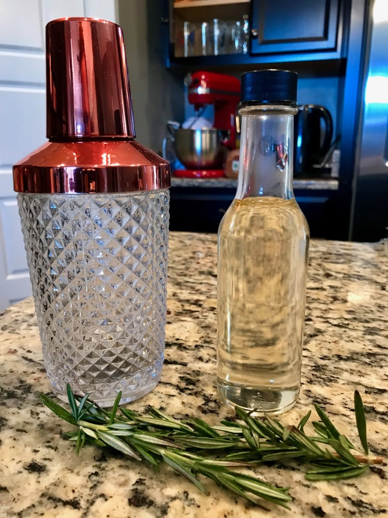 Easy Homemade Rosemary Simple Syrup | this rosemary simple syrup makes a great addition to many cocktails, from a rosemary old fashioned to sprucing up a gin & tonic.  And you can add it to baked goods as well!