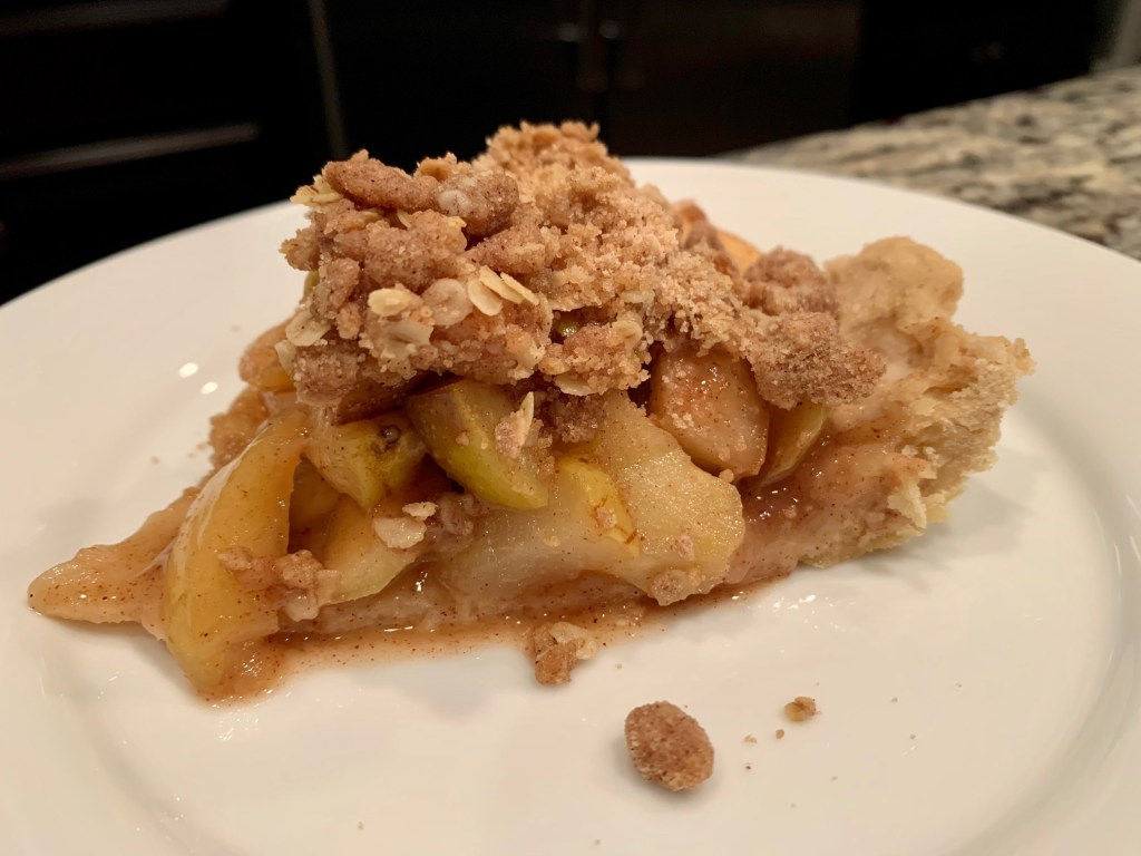 Slice of pear-apple pie with streusel topping