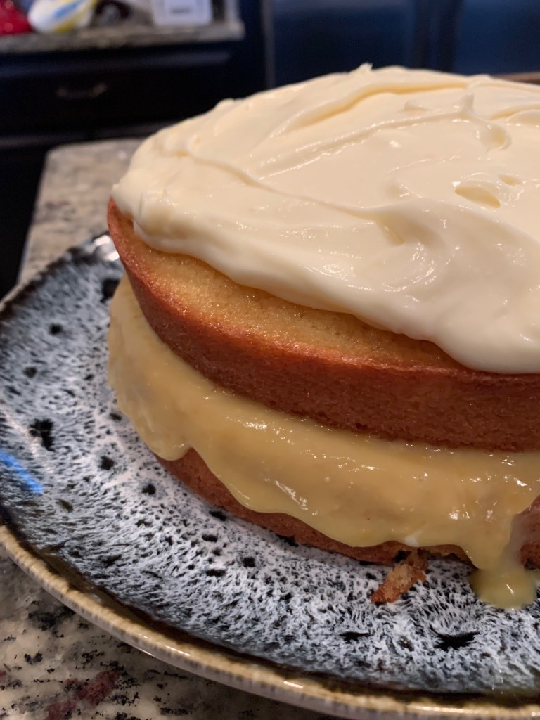 Fresh Grapefruit Cake with Mascarpone Frosting   This delicious, buttery fresh grapefruit cake recipe is light and summery, and has tart grapefruit curd and a creamy icing. A wonderful citrus spring dessert with pink grapefruit. #citrus #grapefruit #cake #mascarpone #grapefruitcurd