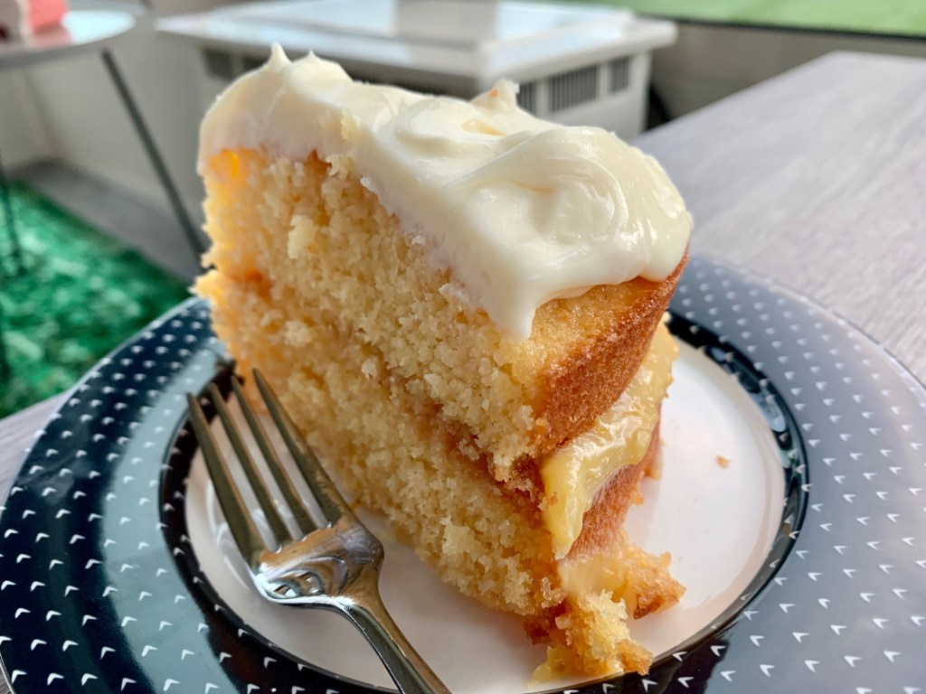 Fresh Grapefruit Cake with Mascarpone Frosting | This delicious, buttery fresh grapefruit cake recipe is light and summery, and has tart grapefruit curd and a creamy icing. A wonderful citrus spring dessert with pink grapefruit. #citrus #grapefruit #cake #mascarpone #grapefruitcurd