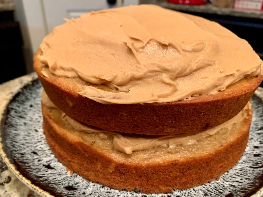 This banana cake with peanut butter frosting is perfect for any occasion & super easy