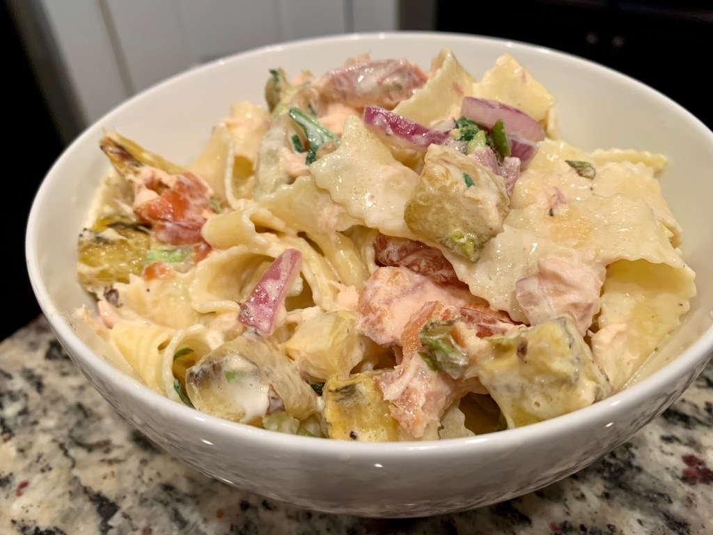 Creamy Smoked Salmon Pasta with Veggies   This delicious & super easy pasta recipe is like a smoked salmon bagel but in pasta form...smoked salmon, creme fraiche, red onion or shallots, capers, & delicious vegetables. A perfect summer pasta recipe, very light pasta recipe. A great way to use up salmon filets.