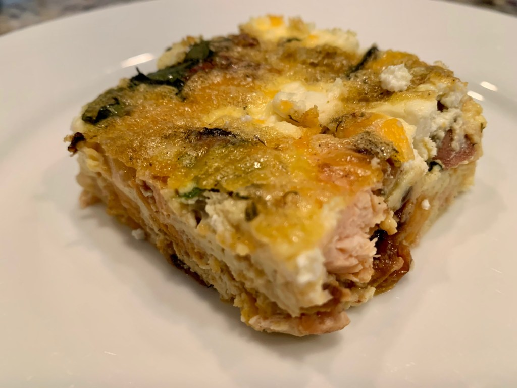 Egg & Salmon Breakfast Casserole with Goat Cheese & Veggies | This delicious and easy brunch recipe is a great way to use up leftover salmon filets (cooked) and use up all the produce you have sitting around. A unique breakfast recipe, perfect way to use up salmon leftovers. Healthy breakfast recipe, can make ahead. #salmon #eggcasserole #breakfastrecipe #brunch