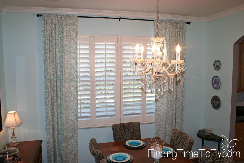 Dining room in light blues and medium wood tones done on a budget. Great tips for saving money!
