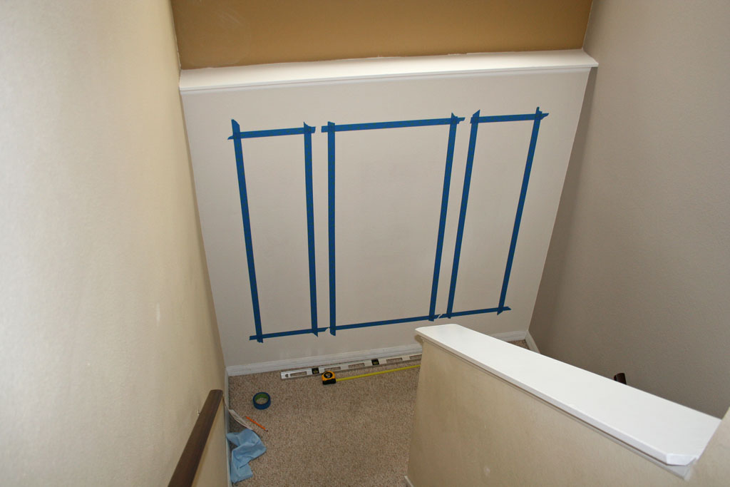 How To Decorate A Stairway Landing Wall With Paint And Moulding