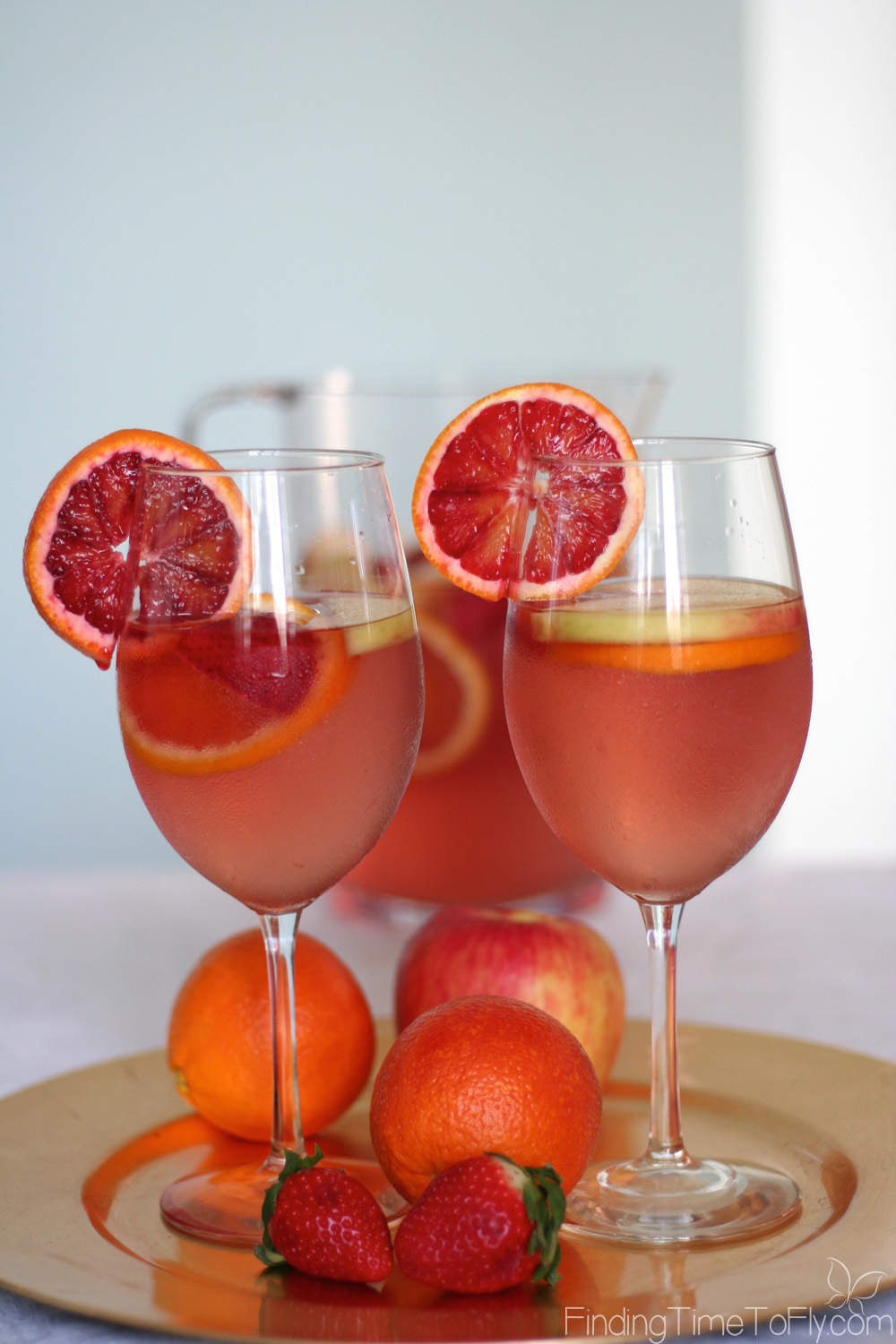 Blood orange, pink grapefruit, honey crisp apple, and strawberries in sangria! Yum! I love Sangria, and the fruits in this one sound delicious. Pink Moscato Sangria would be great for spring, Valentine's Day or any hot summer's day.