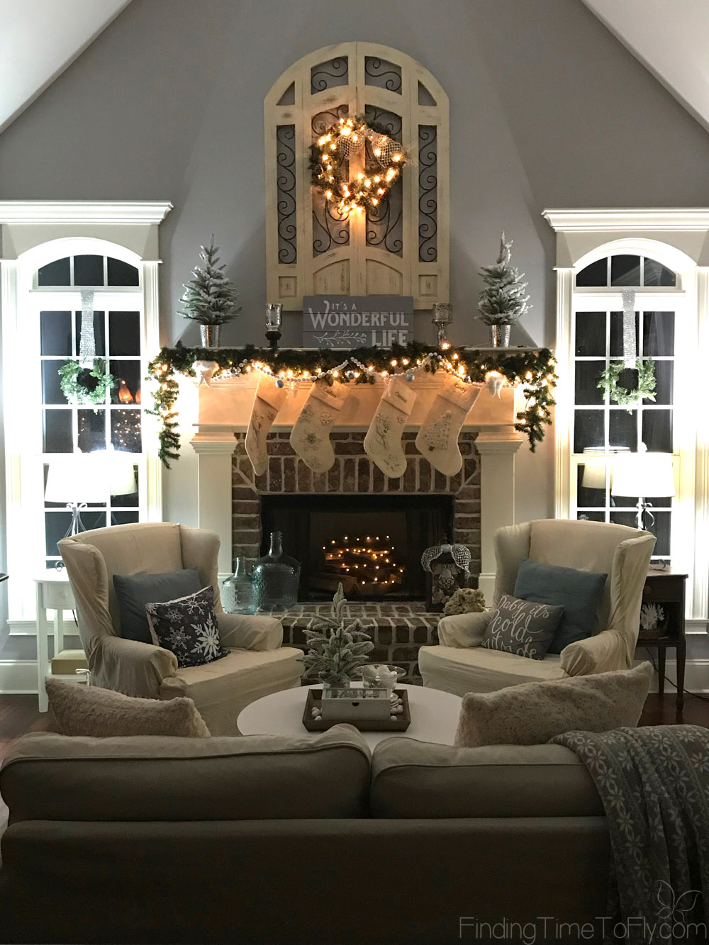 A gorgeous Keeping Room decorated for Christmas in the theme of It's a Wonderful Life with shades of gray, soft whites, jingle bells, angel wings, and snow.